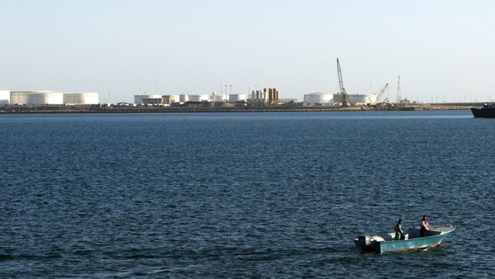 A speed boat passes by oil docks at the port of Kalantari in the city of Chabahar, east of the Strait of Hormuz. (Reuters File)