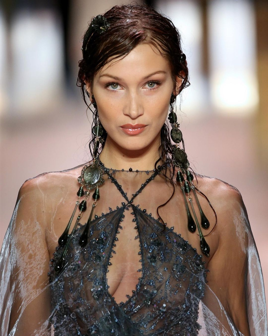 Deep blues, flowing transparencies and opulent embroideries: Bella Hadid's multilayer gown is paired with a mother-of-pearl minaudiere bag, strung from a chain embellished with natural black pearls. (Photo: Instagram/Fendi)