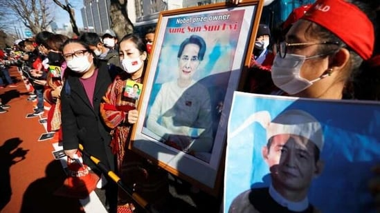 Protesters from Myanmar residing in Japan hold portraits of leader Aung San Suu Kyi and Myanmar's President Win Myint at a rally against Myanmar's military after it seized power. (Reuters Photo )
