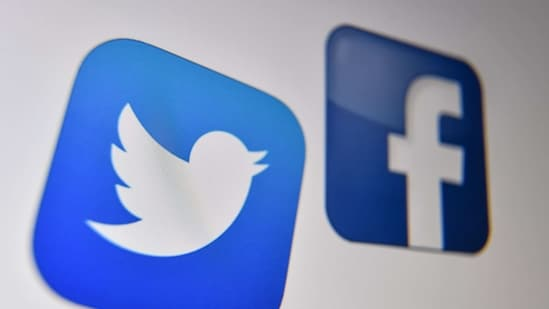 The logo of the the American online social media and social networking service, Facebook and Twitter on a computer screen in Lille. (AFP)