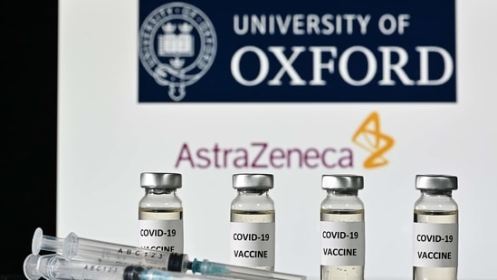 (FILES) This file illustration photo taken on November 17, 2020 shows vials with Covid-19 Vaccine stickers attached and syringes, with the logo of the University of Oxford and its partner British pharmaceutical company AstraZeneca. - France will decide on February 2, 2021 if the Covid-19 vaccine manufactured by AstraZeneca can be used to vaccinate elderly recipients. (Photo by JUSTIN TALLIS / AFP)(AFP)