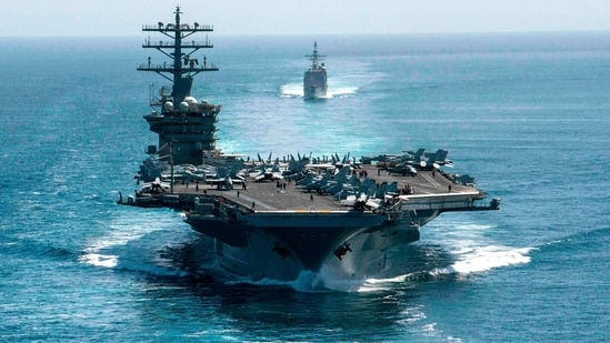 The aircraft carrier USS Nimitz and the guided-missile cruiser USS Philippine Sea in formation during a Strait of Hormuz transit.(AFP File Photo )