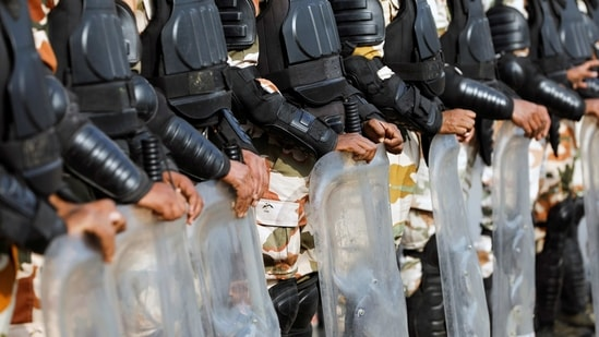 Police officers in riot gear stand guard at the site of a protest against the farm laws at Singhu border in New Delhi, India, January 30, 2021. (REUTERS)
