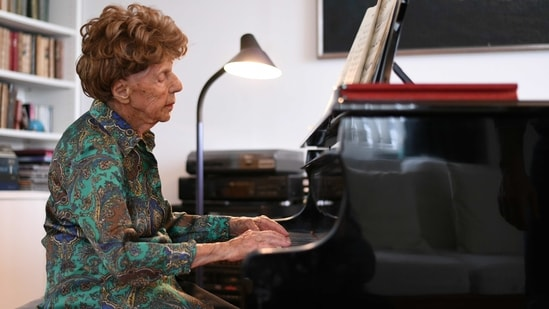 Pianist Colette Maze, 106 years old, plays piano.(REUTERS)