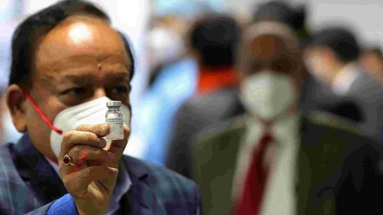 Union health minister Harsh Vardhan displays a vial of Bharat Biotech Ltd. Covaxin at the All India Institute of Medical Sciences in New Delhi on Saturday.(Bloomberg Photo )
