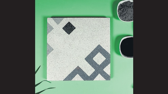 Carbon Craft Design (CCD) works with tyre processing plants to capture recovered carbon black, and then works with craftsmen in Gujarat to incorporate it into tile patterns.