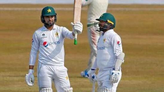 Pakistan's Faheem Ashraf, left, raises bat(AP)