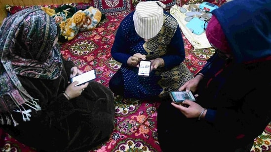 People using the internet as 4G Internet to be restored across Jammu And Kashmir after 18 Months, in Srinagar on Friday. (ANI Photo)