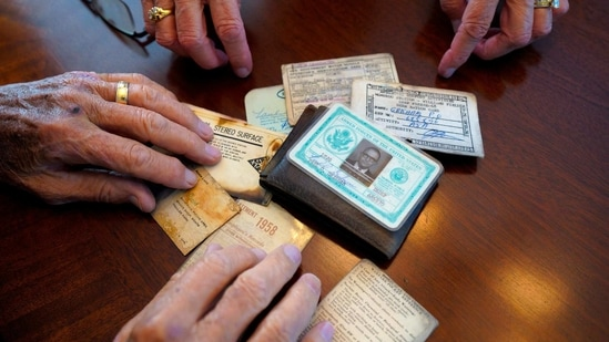 Paul Grisham and his wife Carole Salazar look over his wallet and the items that were inside when he lost it in Antarctica back in 1968 at their home in the San Carlos neighborhood of San Diego, Calif., Wednesday, Feb. 3, 2021. (AP)