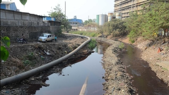 The 17.5-km pipeline to carry waste from factories into Kalyan creek is being readied. (Rishikesh Choudhary/HT photo)