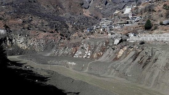 Mud and slash are seen in the Dhauliganga River after a portion of Nanda Devi glacier broke off in Tapovan area of the northern state of Uttarakhand, Sunday, Feb.7, 2021.(AP)
