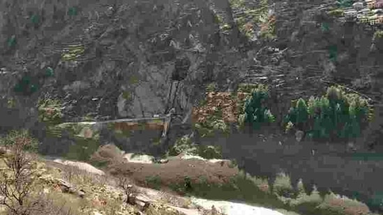 A view of damaged dam after a glacier broke and crashed into the dam at Raini Chak Lata village in Chamoli district in Uttarakhand, on Sunday(REUTERS)