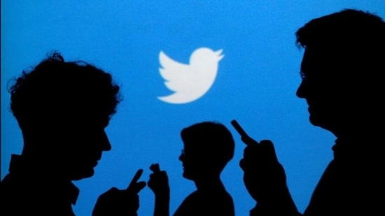 FILE PHOTO: People holding mobile phones are silhouetted against a backdrop projected with the Twitter logo in this illustration picture taken September 27, 2013. REUTERS/Kacper Pempel/Illustration (REUTERS)