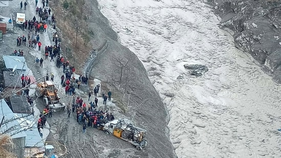 Rescue operations underway near Dhauliganga hydropower project after a glacier broke off in Joshimath causing a massive flood in the Dhauli Ganga river, in Chamoli district of Uttarakhand.(PTI)