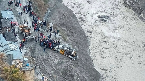 Rescue operations underway near Dhauliganga hydropower project after a glacier broke off in Joshimath causing a massive flood in the Dhauli Ganga river in Chamoli district of Uttarakhand on Sunday.(PTI)