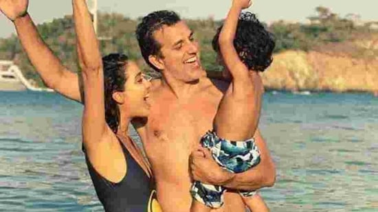 Lisa Haydon poses with her husband, and eldest son.