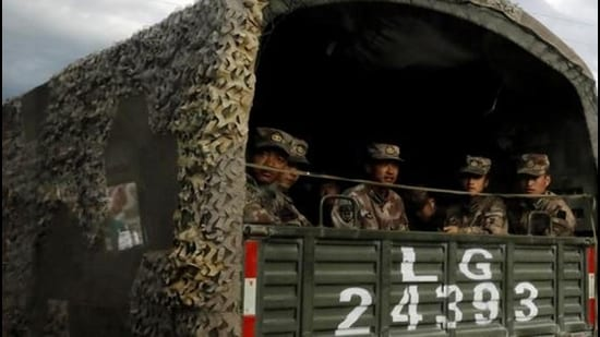 PLA soldiers on the highway to Nyingchi, Tibet Autonomous Region, late in 2020. (File photo)