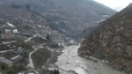 A general view shows the remains of a dam (centre) along a river in Tapovan of Chamoli district on February 8, 2021 destroyed after a flash flood thought to have been caused when a glacier burst on February 7. (Photo by Sajjad HUSSAIN / AFP)(AFP)