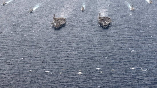 The coordinated operations, combining ships and planes of the two strike groups Theodore Roosevelt and Nimitz, were carried out in a highly-trafficked area to demonstrate the US Navy's ability to operate in challenging environments, the US Pacific Fleet said in a statement on Tuesday on the exercises that angered China.(US Department of Defense)