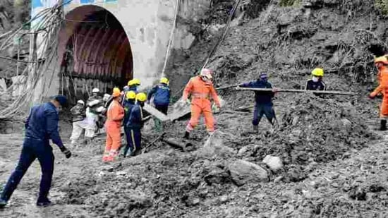 NDRF, SDRF, ITBP and army personnel carrying out search and rescue operation while clearing the debris of a tunnel after the glacier burst in Chamoli, Uttarakhand. (ANI)