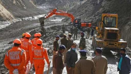 NDRF personnel clear debris in Tapovan, in Uttarakhand on Tuesday.(AP Photo)