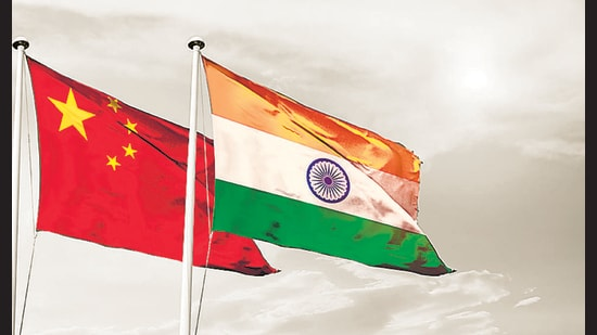 China India national flag cloth fabric waving on the sky with beautiful sun light - Image (Shutterstock)