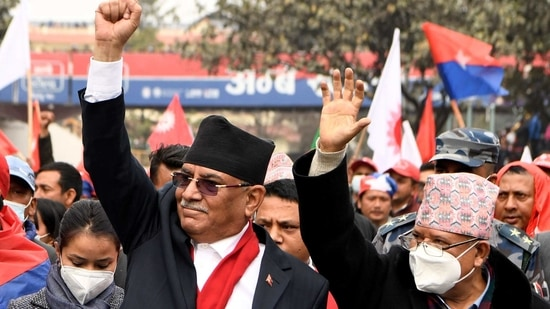 "Prachanda (left, in picture) a former prime minister, said protests to oppose Oli's ""unconstitutional"" move would rage across Nepal.(AFP)"
