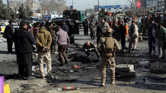 Security personnel inspect the site of a deadly bomb attack in Kabul, Afghanistan, Wednesday.(AP)