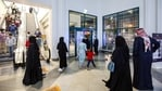 People exit a shopping mall as it closes early according to government-imposed Covid-19 coronavirus pandemic restrictions in Kuwait City.(AP)