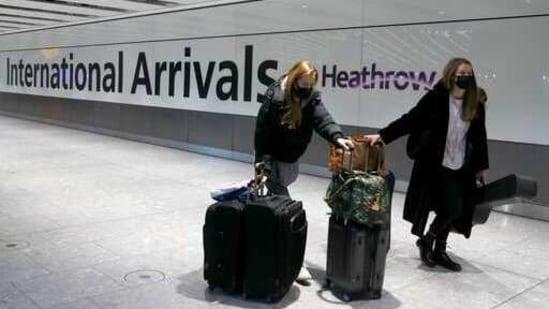 Travelers arrive at Heathrow Airport in London.(AP)