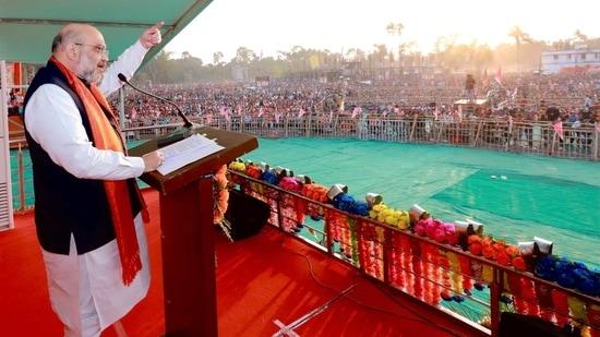Union Home Minister Amit Shah during a public meeting at Thakurbari ground in Thakurnagar on Thursday. (ANI Photo)