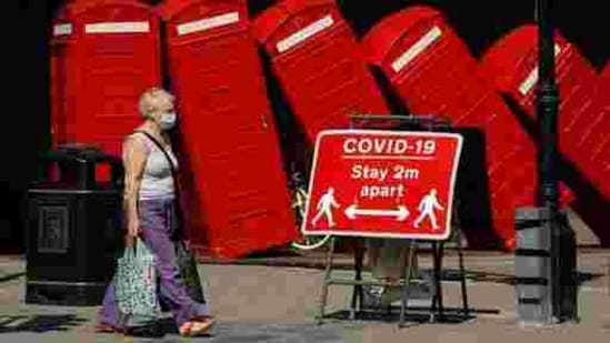 A sign requests people to stay two meters apart to reduce the spread of Covid-19 in London.(AP Photo)