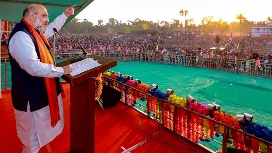 Union home minister Amit Shah addresses a public meeting at Thakurbari in Thakurnagar in Bengal on Thursday, (PTI PHOTO).