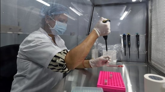 A healthcare worker tests samples in newly launched Spice Health portable RT-PCR testing laboratory at BKC in Mumbai on Thursday. (Satish Bate/HT Photo)