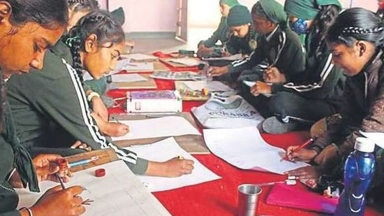 Students of Sri Guru Hargobind Public School, Thakkarwal, Ludhiana, participating in a painting contest.