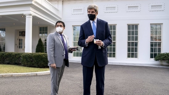 John Kerry, special presidential envoy for climate, right, wears a protective mask while departing a television interview outside the White House in Washington, D.C., U.S., on Wednesday, Jan. 27, 2021. Kerry�said China's net-zero goal needs fleshing out, as he urged countries to be bolder in their efforts to reduce emissions. Photographer: Stefani Reynolds/Bloomberg(Bloomberg)