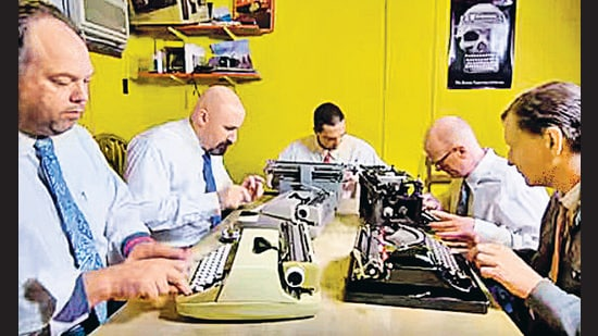 Members of the Boston Typewriter Orchestra get ready to jam without paper jams.
