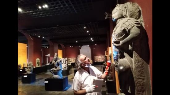 Anupam Sah, head of conservation at CSMVS, inspects an artefact during the lockdown. (Image courtesy CSMVS)
