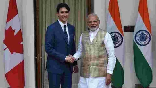 Narendra Modi and Justin Trudeau did exchange smiles and pleasantries at the G20 Summit in Argentina, that warmth masked what officials are resigned to — a chill that is unlikely to thaw for another year.(AFP/File Photo)