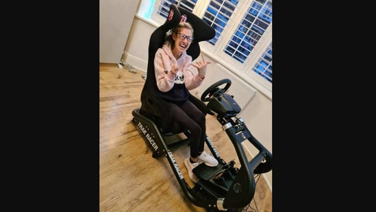 The image shows Hannah Cheetham in her new car simulator chair.(Instagram/@cheethamswithdreams)