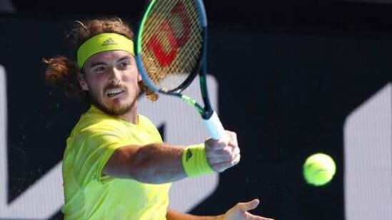Greece's Stefanos Tsitsipas hits a forehand to Sweden's Mikael Ymer during their third-round match at the Australian Open tennis championships in Melbourne.(AP)