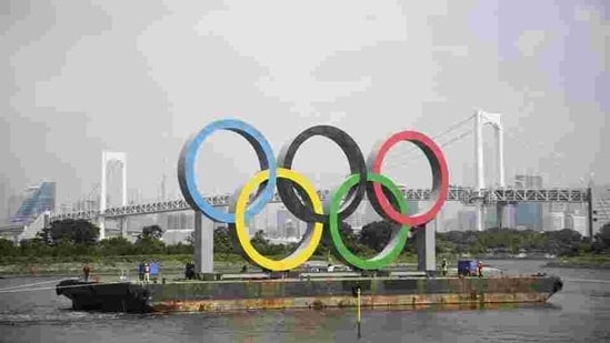 File photo, the Olympic rings for the Olympic and Paralympic Games Tokyo 2020 pass by on a barge by tugboats off the Odaiba Marine Park in Tokyo.(AP)