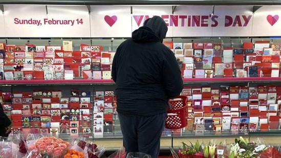 A shopper at a Chicago area store looks over Valentine's Day cards Saturday, Feb. 13, 2021.(AP )