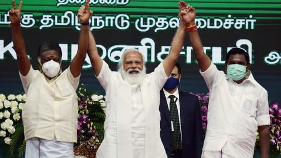 Prime Minister Narendra Modi with Tamil Nadu Chief Minister Edappadi K Palaniswami and Deputy Chief Minister O Panneerselvam during the inauguration and laying the foundation of various projects, in Chennai on Sunday. (ANI PHOTO).