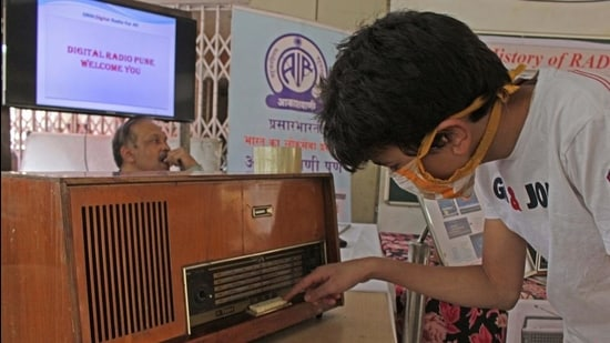 People examine old are rare radio models during an exhibition at Muktangan Science Exploratory , on Saturday. (Ravindra Joshi/HT PHOTO)