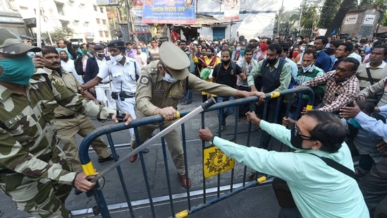 Para-teachers scuffle with police personnel during a protest over payscale and other issues, in Kolkata in this file picture from Feb 5. (PTI Photo)