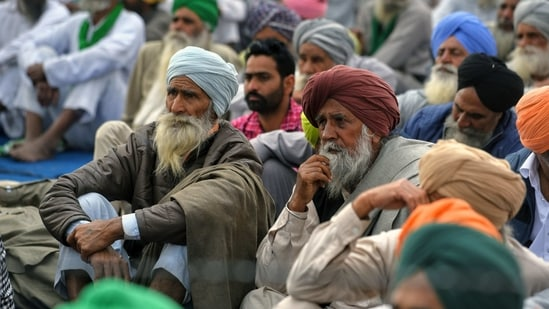 Farmers sitting at Tikri Border during their ongoing protest against the farm laws, in New Delhi on Sunday. (ANI Photo)