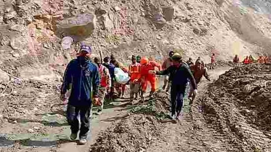 Personnel of the Indo-Tibetan Border Police (ITBP) are seen during their search and rescue operation to look for missing people at Raini village in Uttarakhand's Chamoli on Sunday. (ANI Photo)