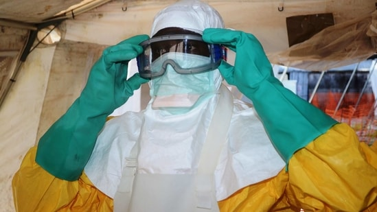 A member of Doctors Without Borders (MSF) putting on protective gear at the isolation ward of the Donka Hospital in Conakry.(File Photo / AFP)