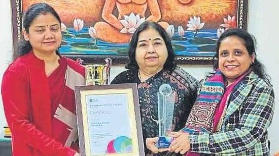 (L-R) School teacher Smritee, principal Anju Puri and ISA coordinator Jyotsna Jha with the award certificate and trophy.